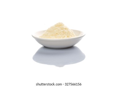 Grated cheese in a white bowl over white background