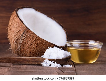 Grated coconut and coconut oil on wood