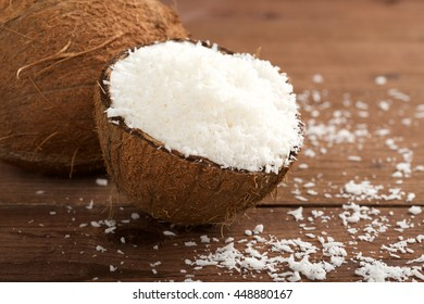 grated coconut on wooden background