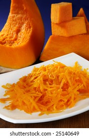 Grated orange pumpkin with slice and cube