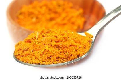 Grated turmeric over white background