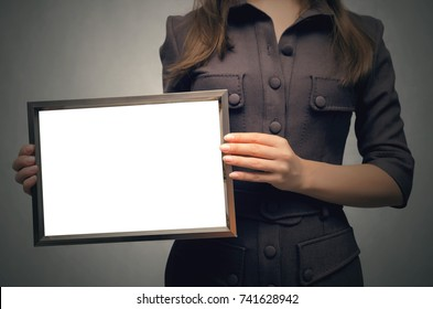 Grateful letter. Gratitude concept. Accolade. Thank letter. Special offer. Young business women in strict dress holding in hands empty blank photo frame. Appreciation document.