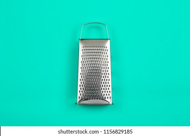 grater on green ground