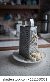 grater on the kitchen grated boiled egg with natural light from the window
