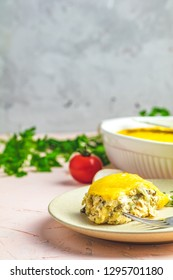 Gratin, julienne or casserole from baked mushroom with chicken and cheese in bechamel sause, portion in plate, shallow depth of the field, copy space for you text.