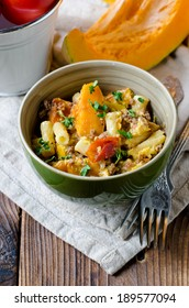 Gratin of pumpkin , pasta and minced meat
