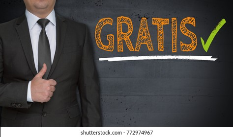 Gratis ( in german free of charge) concept and businessman with thumbs up.