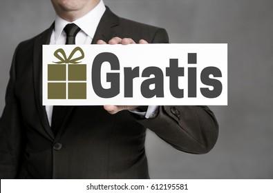 Gratis (in german Free of Charge) shield is held by businessman.