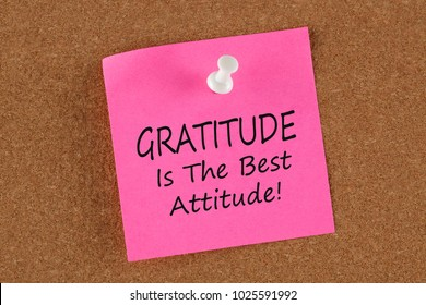 Gratitude Is The Best Attitude written on remember note concept on a cork board.Business Concept.