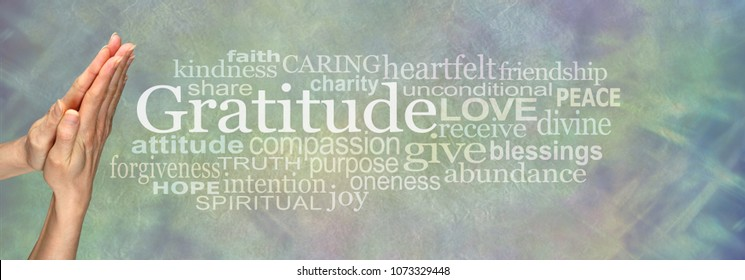Gratitude Prayer Word Tag Cloud     - Female hands in prayer position beside the word GRATITUDE and a relevant word cloud on a pale blue green stone effect background