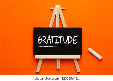 Gratitude written on blackboard on tripod with chalk. Gratitude Practice.