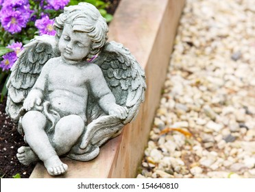 Grave angel before blossoms
