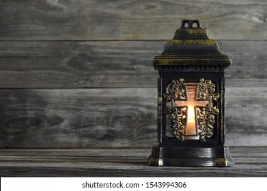 Grave candle on wood background with copy space