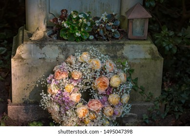 Grave with colorful rosary in a cemetery