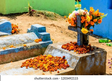 Grave decorated with flowers for All Saints Day on November 1 in Guatemala.