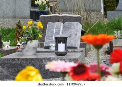 Grave with Flower Arrangement and Tombstone in Form of a Book