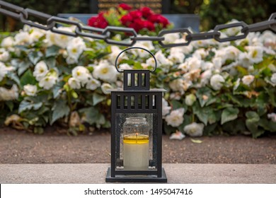 Grave lantern with iron chain in a cemetery