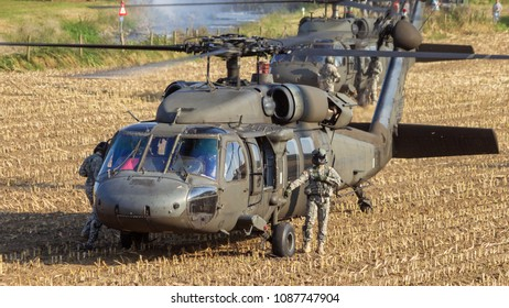 GRAVE, NETHERLANDS - SEP 17, 2014: Two US Army Blackhawk helicopters about to take off from a field