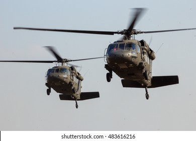 GRAVE, NETHERLANDS - SEP 17, 2014: Two American Army Blackhawk helicopter landing.