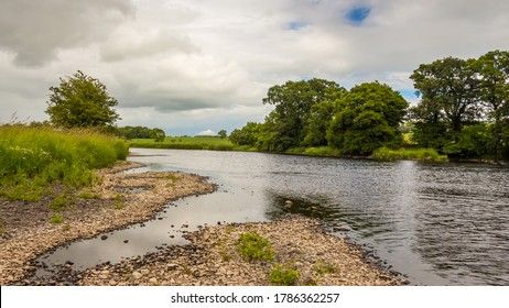 A gravel bar and low water on a lowland Scottish river in summer, River Dee, Galloway, Scotland