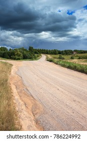 Gravel countryside road in summer afternoon.