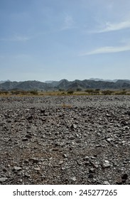 Gravel desert with mountains in background