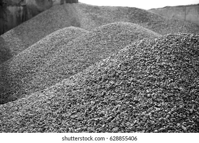 gravel gray stone textures asphalt mix concrete in road construction. Pile rock and stone for Industrial