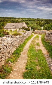 Gravel path to old stone house. Island of Brac, Croatia.