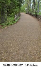 gravel path with stick fence portrait aspect