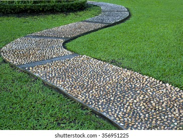 gravel pebble rock stone curvy pathway in the park garden
