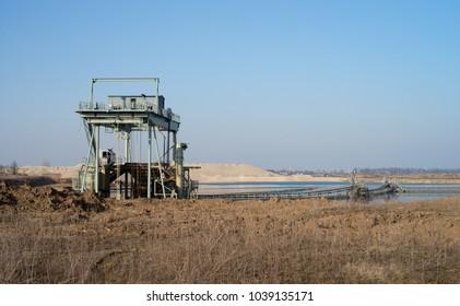 Gravel pit with conveyor belt