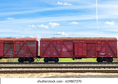Gravel railway with red cargo train wagons on it