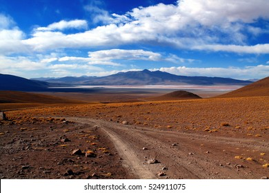 gravel road with breathless panorama to the laguna verde in the national park eduardo avaroa in bolivia