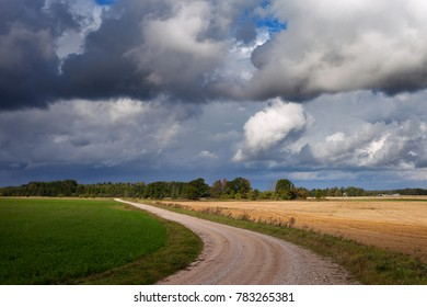 Gravel road in cloudy day.