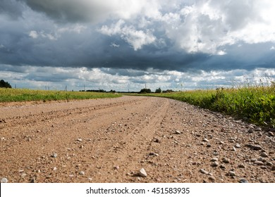 Gravel road in latvian countryside.