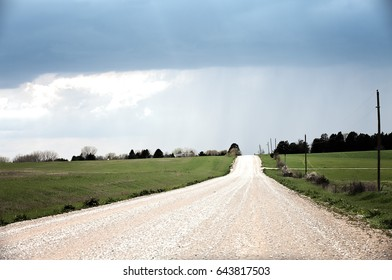 Gravel road outside of Lincoln Nebraska with stormy clouds