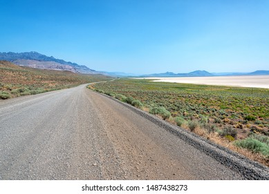 Gravel road passing through the Alvord Desert in southeast Oregon in Harney County