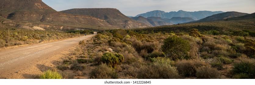 Gravel road running through a desolate rural landscape near Montagu. Western Cape. South Africa