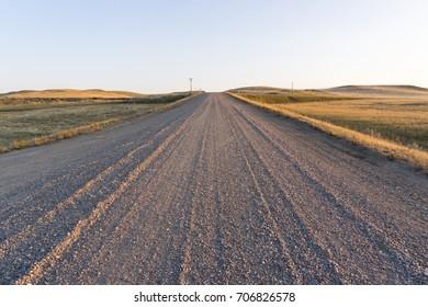 Gravel road at sunset in Saskatchewan, Canada.