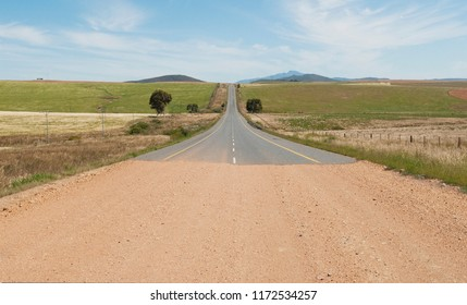 Gravel road and tar road meet in the countryside