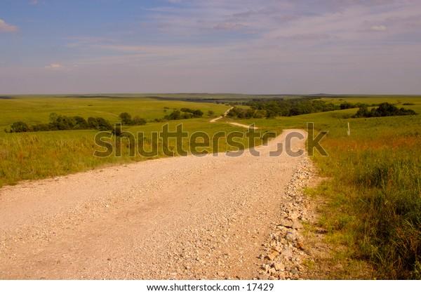 Gravel road through countryside.