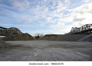gravel yard and concrete supply make man made landscapes from gravel and sand.