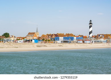 Gravelines,Petit-Fort Philippe,FRANCE-July 19,2017: View of the lighthouse, river and buildings of the small town of Petit-Fort-Philippe.Petit-Fort Philippe is a small tourist town by the North Sea.