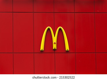 Gravenhurst, Canada - June 12, 2014 - The yellow McDonald's Canada symbol on a vibrant red tiled wall outside of the famous restaurant in Gravenhurst, Ontario.