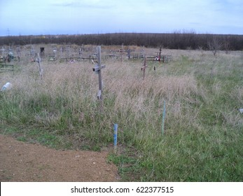 graves with crosses in the cemetery