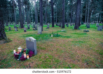 Graves in the forest of the Skogskyrkogarden cemetery in Stockholm on All Saints Day