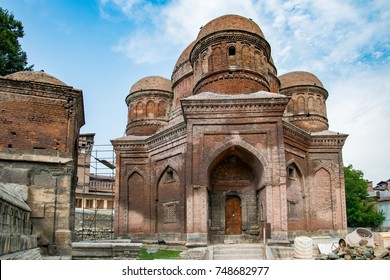 Graves surround the Tomb of Budshah, a popular tourist attraction in Srinagar, Kashmir, India.