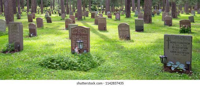 Graves of the Woodland Cemetery (Skogskyrkogarden), Stockholm, Sweden - 26 Jun 2018: In 1994, Skogskyrkogarden was named a UNESCO World Heritage Site.