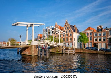 Gravestenenbrug bridge on Spaarne river and old houses in Haarlem, Netherlands