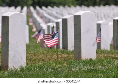 Gravestones decorated with U.S. flags to commemorate Memorial Day at the Arlington National Cemetery in Arlington, Virginia, near Washington DC